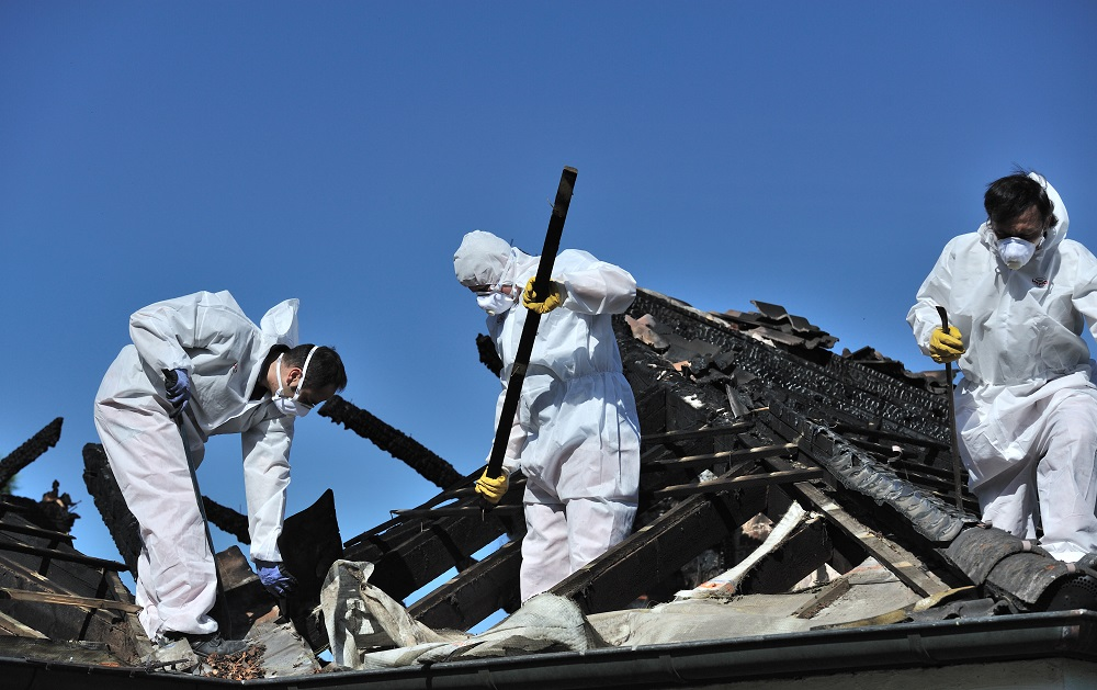 Workers Repairing Fire Damage