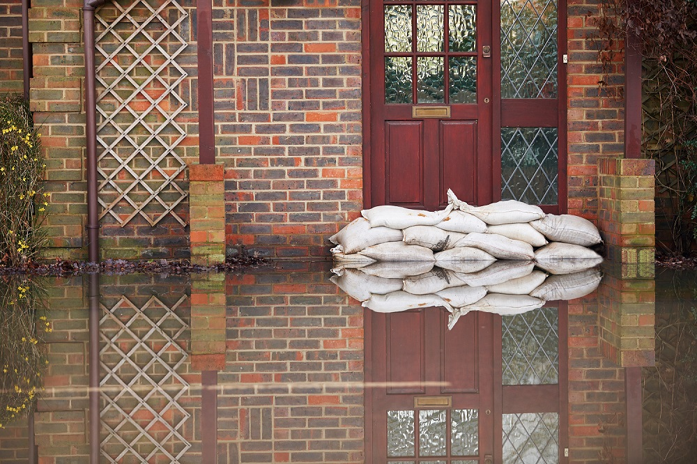 Sandbags Outside Front Door of Red Brick House